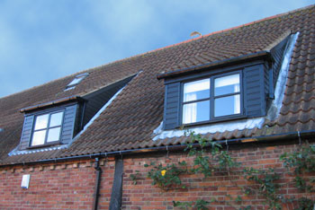 Mews house in Leicestershire with Swish black cladding, fascia and guttering